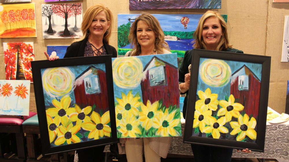 Long-time girlfriends painting and laughing together!